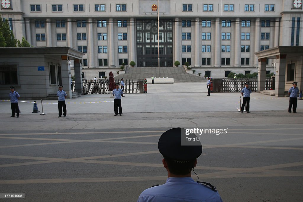Chinese policemen guard before former Chinese politician Bo Xilai leaving the Jinan Intermediate People's Court after first day trial on August 22, 2013 in Jinan, China. Former Chinese politician Bo Xilai is standing trial on charges of bribery, corruption and abuse of power. Bo Xilai made global headlines last year when his wife Gu Kailai was charged and convicted of murdering British businessman Neil Heywood.