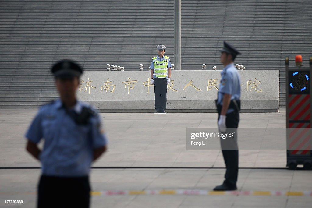 Chinese policemen guard during the third day of former Chinese politician Bo Xilai's trial at Jinan Intermediate People's Court on August 24, 2013 in Jinan, China. Ousted Chinese politician Bo Xilai is standing trial on charges of bribery, corruption and abuse of power for a third day. Bo Xilai made global headlines last year when his wife Gu Kailai was charged and convicted of murdering British businessman Neil Heywood.