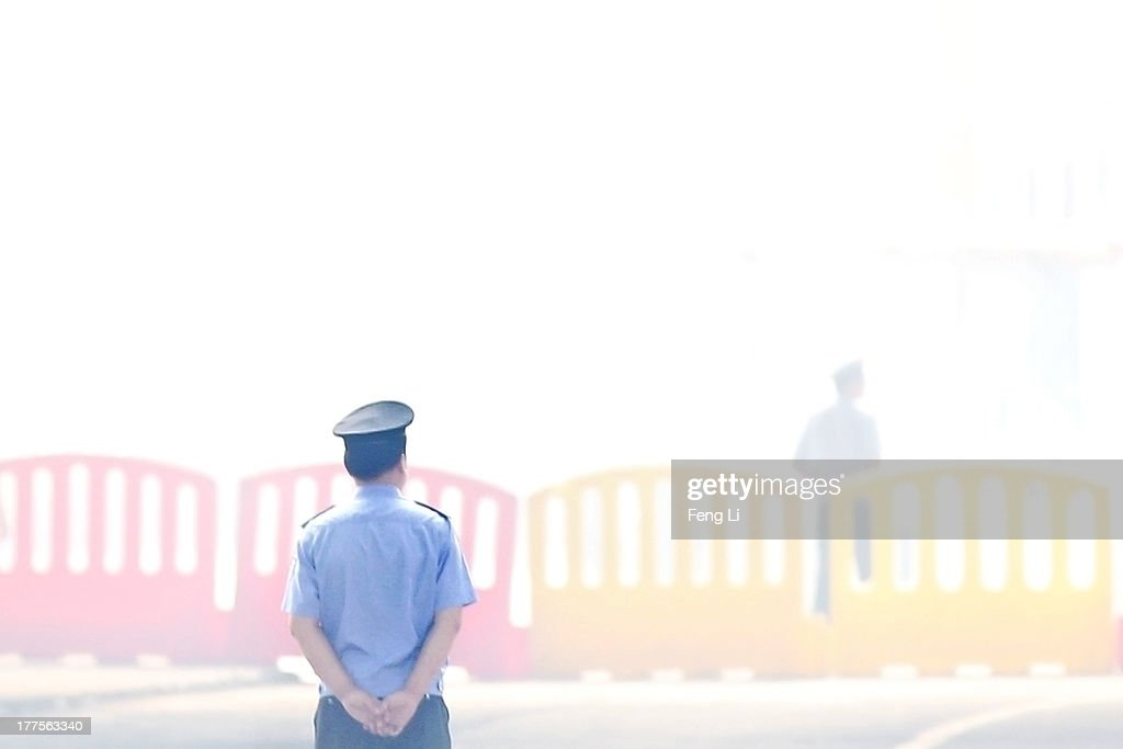 Chinese policemen guard during the third day of former Chinese politician Bo Xilai's trial outside Jinan Intermediate People's Court on August 24, 2013 in Jinan, China. Ousted Chinese politician Bo Xilai is standing trial on charges of bribery, corruption and abuse of power for a third day. Bo Xilai made global headlines last year when his wife Gu Kailai was charged and convicted of murdering British businessman Neil Heywood.