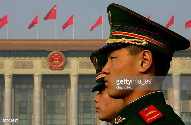 Chinese policemen guard in front of the Great Hall of the People during the opening ceremony of the National People's Congress China's parliament on...