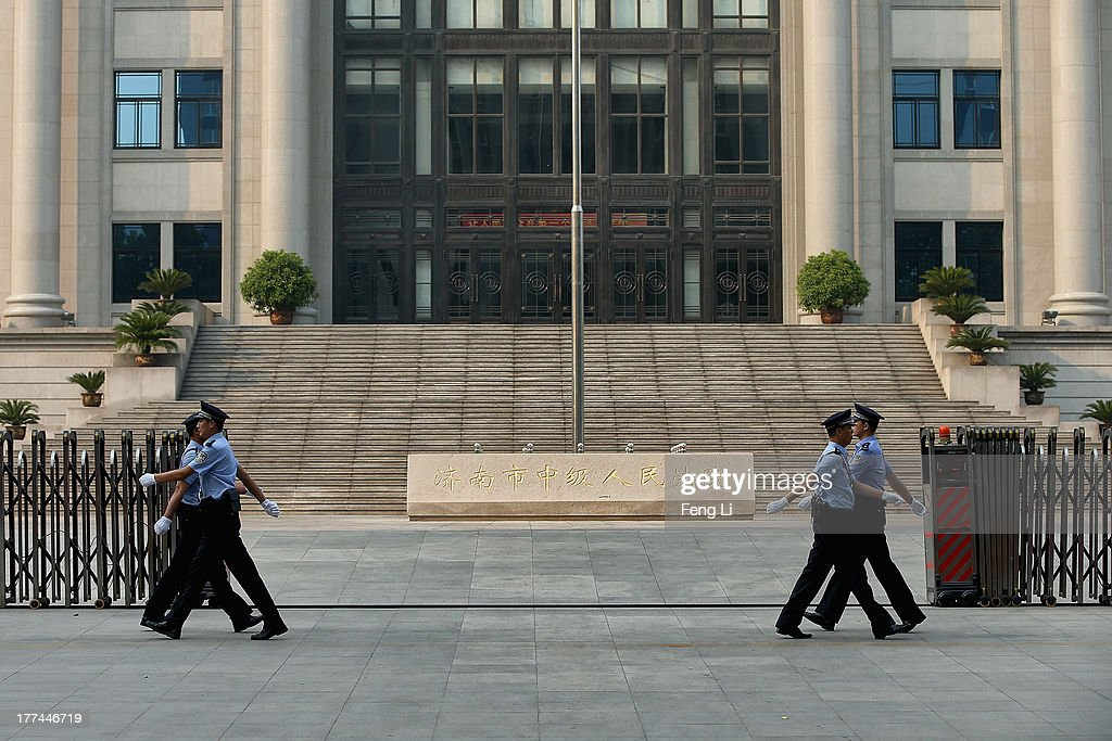 Chinese policemen guard outside the gate of the Jinan Intermediate People's Court on August 23, 2013 in Jinan, China. Ousted Chinese politician Bo Xilai is standing trial on charges of bribery, corruption and abuse of power for a second straight day. Bo Xilai made global headlines last year when his wife Gu Kailai was charged and convicted of murdering British businessman Neil Heywood.