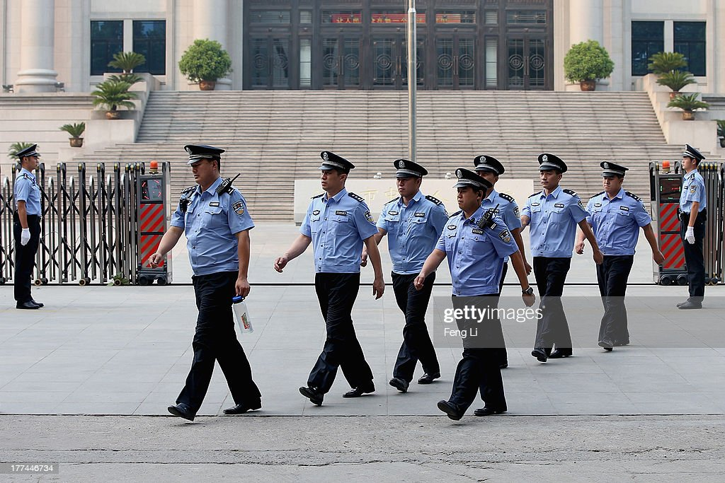 Chinese policemen guard outside the Jinan Intermediate People's Court on August 23, 2013 in Jinan, China. Ousted Chinese politician Bo Xilai is standing trial on charges of bribery, corruption and abuse of power for a second straight day. Bo Xilai made global headlines last year when his wife Gu Kailai was charged and convicted of murdering British businessman Neil Heywood.