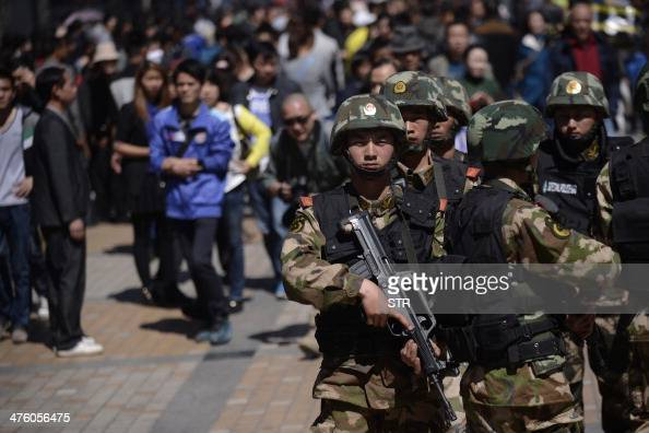 Chinese policemen patrol a street near the railway station in Kunming southwest China's Yunnan province on March 2 2014 Knifewielding assailants left...