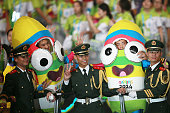 Chinese policemen pose for photos with mascots after the closing ceremony for the Nanjing 2014 Summer Youth Olympic Games at the Nanjing Olympic...