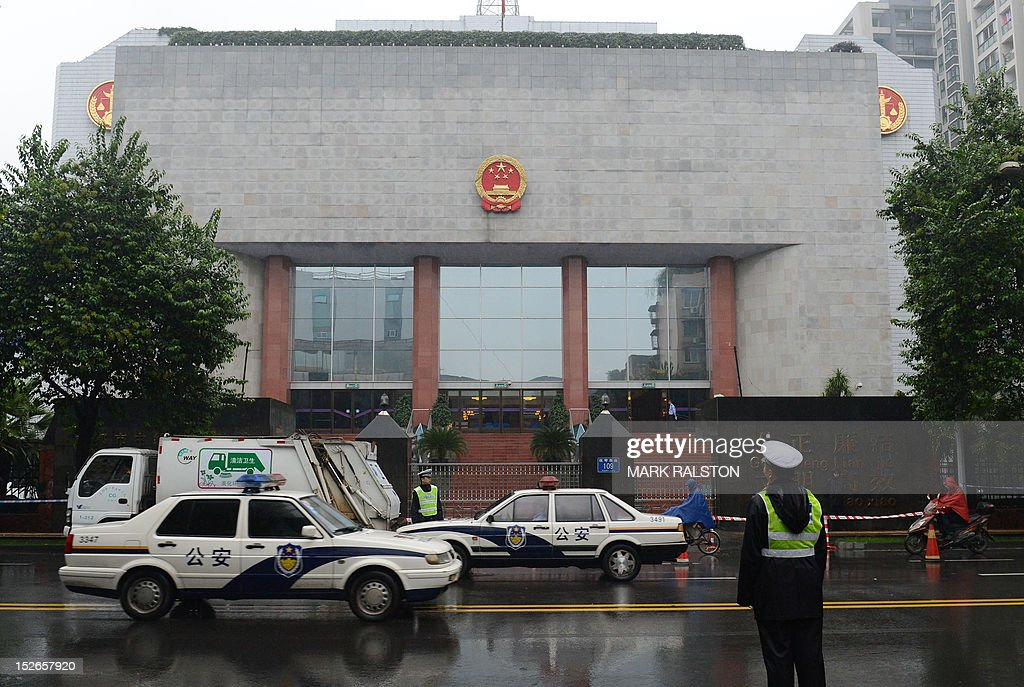 Chinese policemen stand guard outside the Chengdu People's Intermediate court in Chengdu in southwest China's Sichuan province on September 24 where...