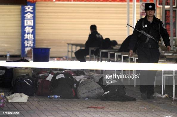 Chinese policemen stands next to the luggage left behind by passengers after an attack on the railway station in Kunming southwest China's Yunnan...