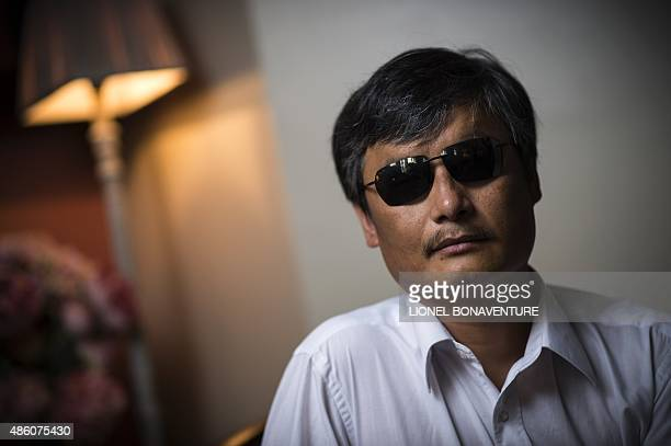 Chinese popular human rights activist Chen Guangcheng poses in Paris on August 31 2015 Chen who enraged authorities by exposing forced abortions and...
