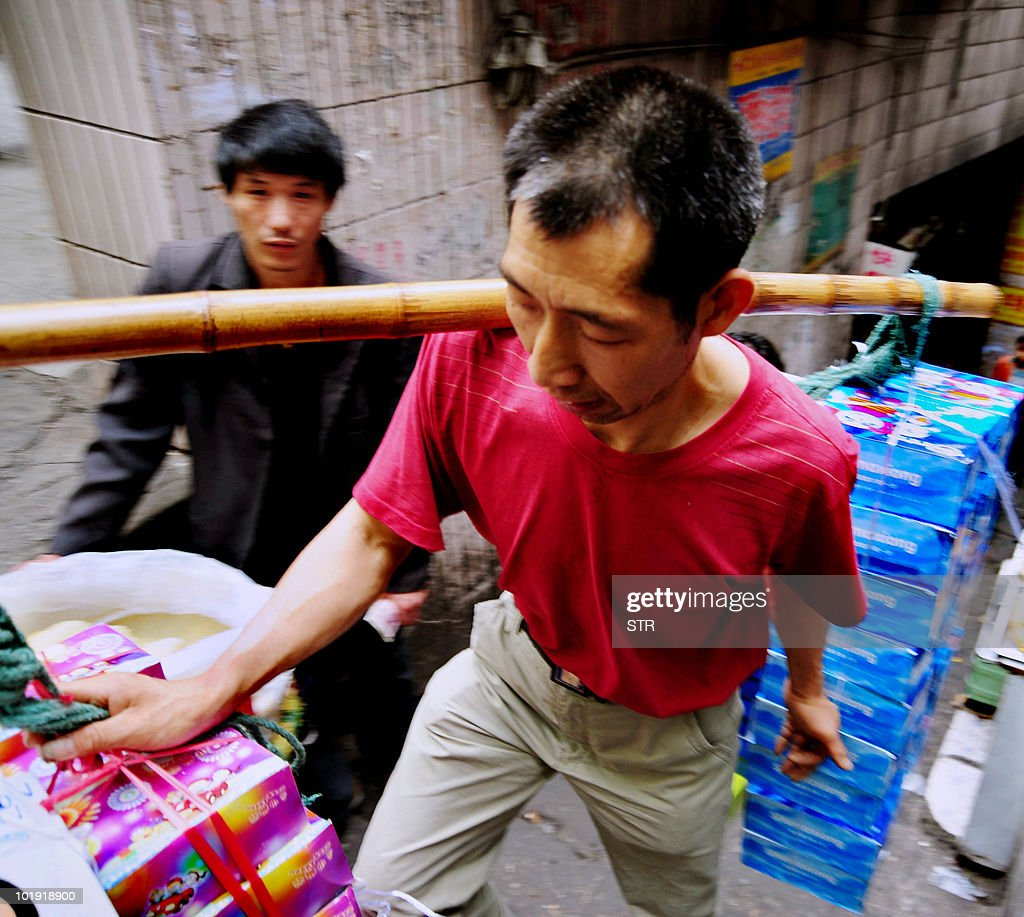 A Chinese porter also known as a 'Bang Bang' in the local dialect refering to the way they carry goods transports wares on May 19 2010 in southwest...
