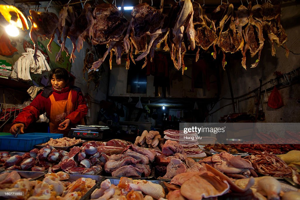 A Chinese poultry vendor waits for customers at an outdoor market on February 5, 2013 in Shanghai, China. Chinese citizens are stocking up on food ahead of the upcoming Chinese Lunar New Year, also known as Spring Festival, is one of the most important festivals in China and falls this year on February 10, 2013.