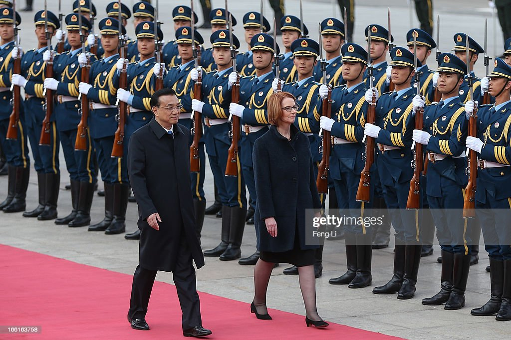Chinese Premier Li Keqiang (Left) accompanies Australian Prime Minister Julia Gillard (Right) to view an honour guard during a welcoming ceremony outside the Great Hall of the People on April 9, 2013 in Beijing, China. At the invitation of Chinese Premier Li Keqiang, Australian Prime Minister Julia Gillard will pay an official visit to China after the Boao Forum for Asia Annual Conference 2013.
