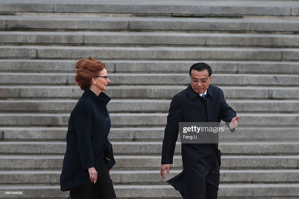 Chinese Premier <a gi-track='captionPersonalityLinkClicked' href=/galleries/search?phrase=Li+Keqiang&family=editorial&specificpeople=2481781 ng-click='$event.stopPropagation()'>Li Keqiang</a> (R) accompanies Australian Prime Minister <a gi-track='captionPersonalityLinkClicked' href=/galleries/search?phrase=Julia+Gillard&family=editorial&specificpeople=787281 ng-click='$event.stopPropagation()'>Julia Gillard</a> (L) to view an honour guard during a welcoming ceremony outside the Great Hall of the People on April 9, 2013 in Beijing, China. At the invitation of Chinese Premier <a gi-track='captionPersonalityLinkClicked' href=/galleries/search?phrase=Li+Keqiang&family=editorial&specificpeople=2481781 ng-click='$event.stopPropagation()'>Li Keqiang</a>, Australian Prime Minister <a gi-track='captionPersonalityLinkClicked' href=/galleries/search?phrase=Julia+Gillard&family=editorial&specificpeople=787281 ng-click='$event.stopPropagation()'>Julia Gillard</a> will pay an official visit to China after the Boao Forum for Asia Annual Conference 2013.