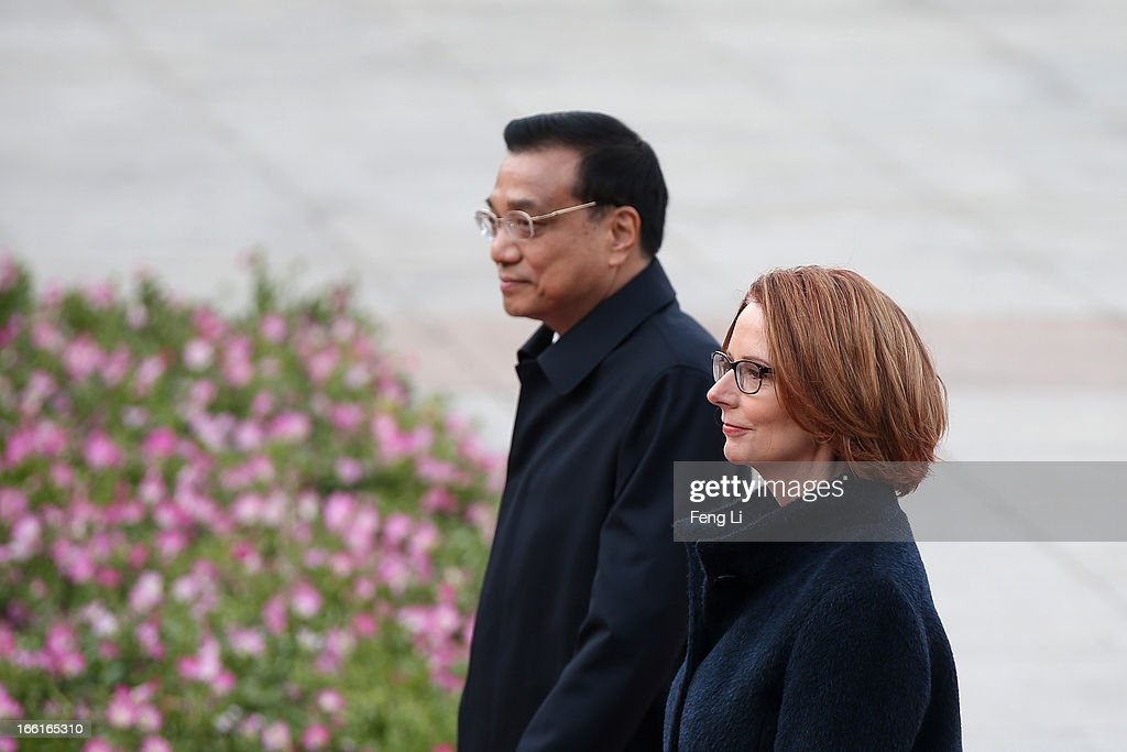 Chinese Premier <a gi-track='captionPersonalityLinkClicked' href=/galleries/search?phrase=Li+Keqiang&family=editorial&specificpeople=2481781 ng-click='$event.stopPropagation()'>Li Keqiang</a> (Left) accompanies Australian Prime Minister <a gi-track='captionPersonalityLinkClicked' href=/galleries/search?phrase=Julia+Gillard&family=editorial&specificpeople=787281 ng-click='$event.stopPropagation()'>Julia Gillard</a> (Right) to view an honour guard during a welcoming ceremony outside the Great Hall of the People on April 9, 2013 in Beijing, China. At the invitation of Chinese Premier <a gi-track='captionPersonalityLinkClicked' href=/galleries/search?phrase=Li+Keqiang&family=editorial&specificpeople=2481781 ng-click='$event.stopPropagation()'>Li Keqiang</a>, Australian Prime Minister <a gi-track='captionPersonalityLinkClicked' href=/galleries/search?phrase=Julia+Gillard&family=editorial&specificpeople=787281 ng-click='$event.stopPropagation()'>Julia Gillard</a> will pay an official visit to China after the Boao Forum for Asia Annual Conference 2013.