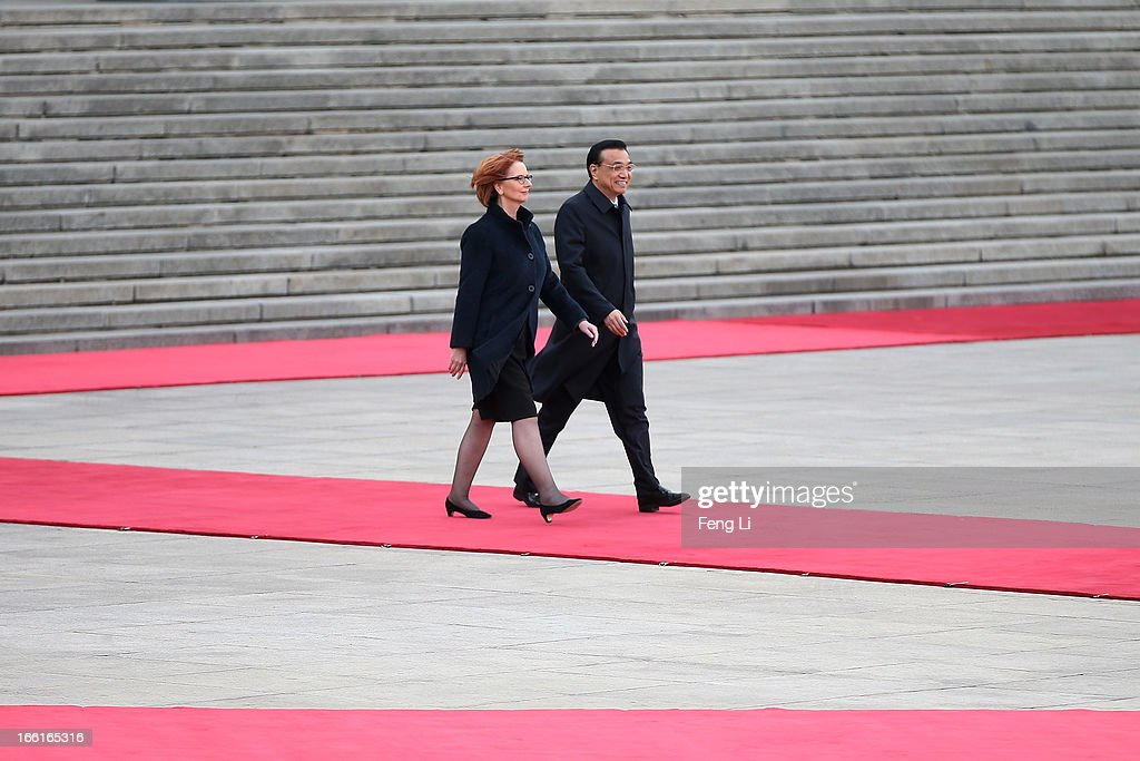 Chinese Premier Li Keqiang (R) accompanies Australian Prime Minister Julia Gillard (L) to view an honour guard during a welcoming ceremony outside the Great Hall of the People on April 9, 2013 in Beijing, China. At the invitation of Chinese Premier Li Keqiang, Australian Prime Minister Julia Gillard will pay an official visit to China after the Boao Forum for Asia Annual Conference 2013.
