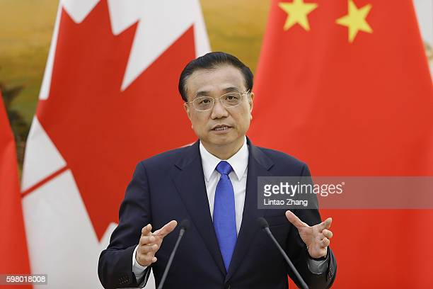 Chinese Premier Li Keqiang addresses a press conference with Canadian Prime Minister Justin Trudeau at the Great Hall of the People on August 31 2016...
