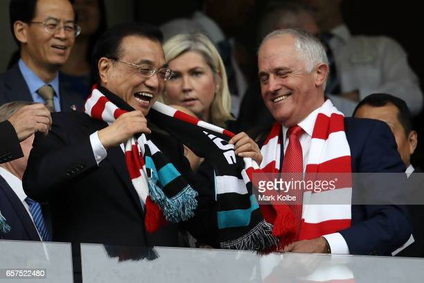 Chinese Premier Li Keqiang and Australia's Prime Minister Malcolm Turnbull share a joke before kickoff during the round one AFL match between the...