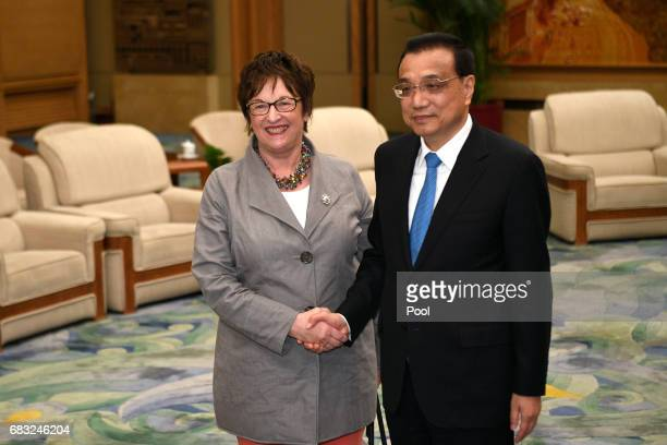 Chinese Premier Li Keqiang and German Minister for Economic Affairs and Energy Brigitte Zypries shake hands before thier meeting on May 15 2017 at...