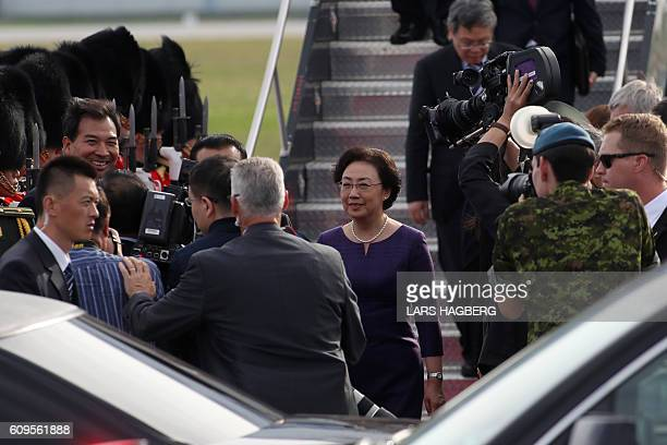 Chinese Premier Li Keqiang and his wife Cheng Hong are surrounded by press as they arrive at MacdonaldCartier International Airport in Ottawa Ontario...