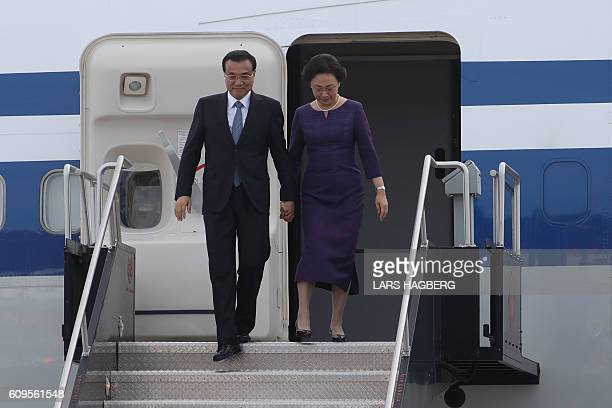 Chinese Premier Li Keqiang and his wife Cheng Hong arrive at the Ottawa MacdonaldCartier International Airport in Ottawa Ontario Canada September 21...