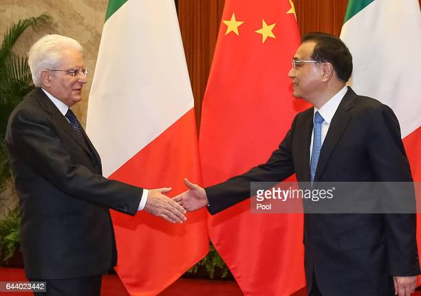 Chinese Premier Li Keqiang and Italian President Sergio Mattarella shake hands during their meeting at the Great Hall of the People in Beijing China...