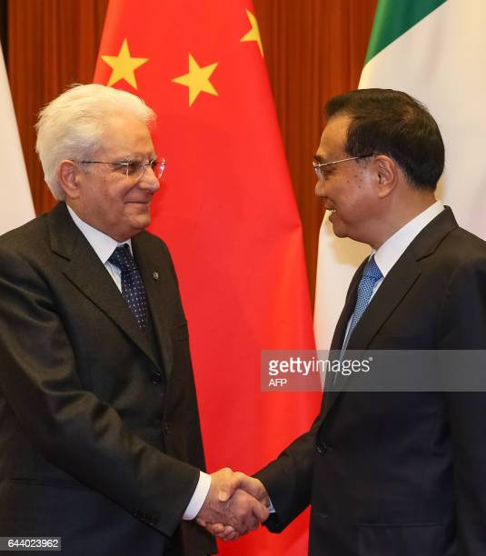 Chinese Premier Li Keqiang and Italian President Sergio Mattarella shake hands during their meeting at the Great Hall of the People in Beijing on...