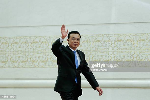 Chinese Premier Li Keqiang arrives for his press conference after the closing session of the 12th National People's Congress at the Great Hall of the...