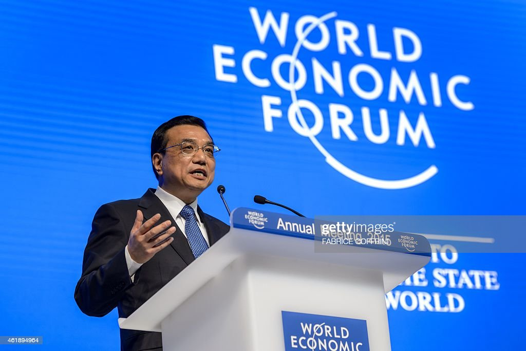 Chinese Premier <a gi-track='captionPersonalityLinkClicked' href=/galleries/search?phrase=Li+Keqiang&family=editorial&specificpeople=2481781 ng-click='$event.stopPropagation()'>Li Keqiang</a> attends a session of the World Economic Forum (WEF) annual meeting in Davos on January 21, 2015. China's economy is not heading for a sharp slow down, Prime Minister <a gi-track='captionPersonalityLinkClicked' href=/galleries/search?phrase=Li+Keqiang&family=editorial&specificpeople=2481781 ng-click='$event.stopPropagation()'>Li Keqiang</a> told business and government elites gathered in Davos today, as he sought to allay fears over the Asian giant's growth outlook. AFP PHOTO / FABRICE COFFRINI
