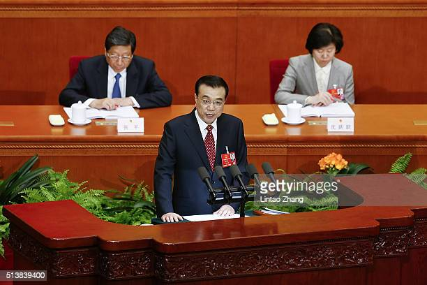Chinese Premier Li Keqiang delivers his report during the opening ceremony of the National People's Congress in the Great Hall of the People on March...