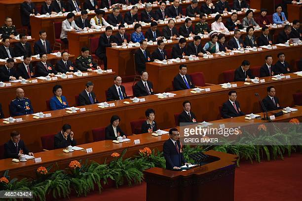 Chinese premier Li Keqiang delivers his work report during the opening of the 3rd Session of the 12th National People's Congress at the Great Hall of...