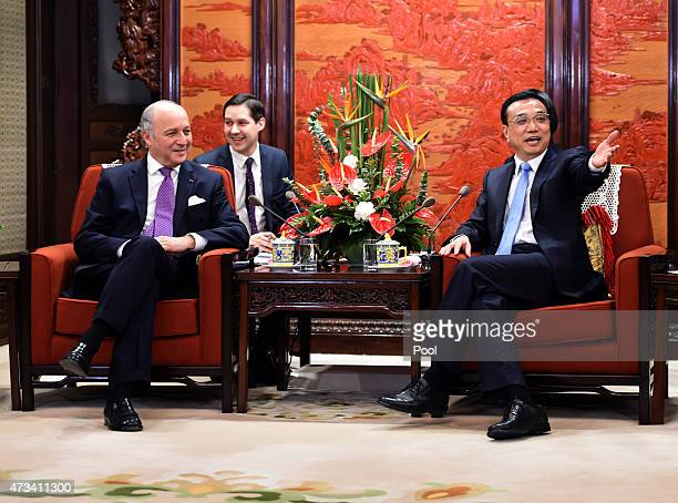 Chinese Premier Li Keqiang gestures as he talks with French Foreign Minister Laurent Fabius during a meeting at the Zhongnanhai leadership compound...