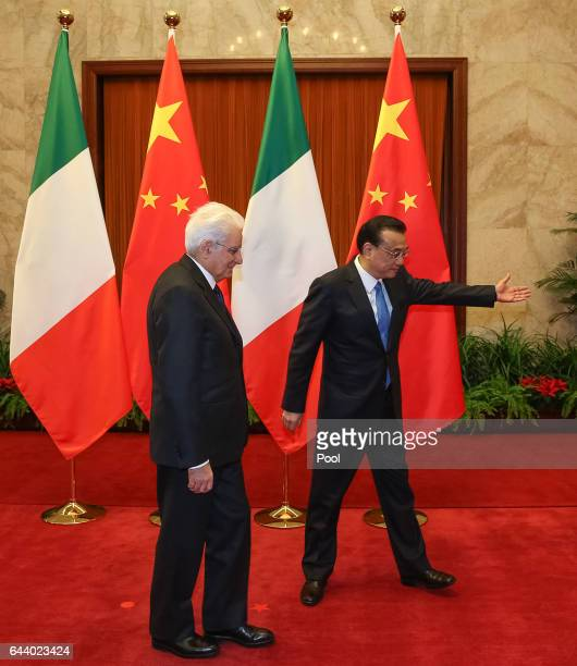 Chinese Premier Li Keqiang gestures to Italian President Sergio Mattarella during their meeting at the Great Hall of the People in Beijing China 23...
