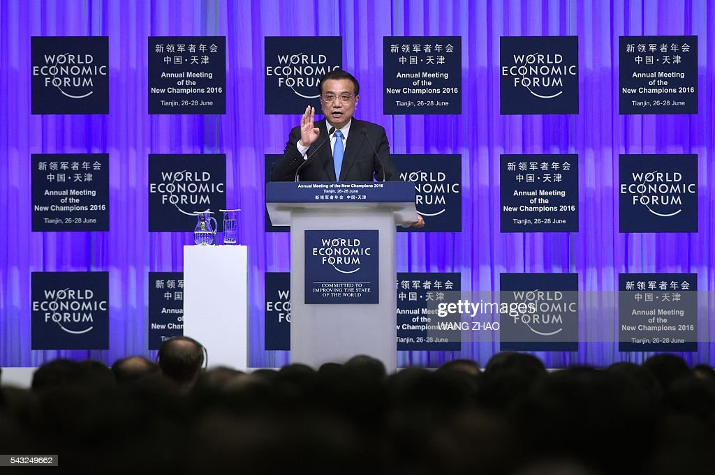 Chinese Premier Li Keqiang gives a speech on the first day of the World Economic Forum in Tianjin on June 27, 2016. The annual World Economic Forum New Champions meeting brings together business, economic and political leaders. / AFP / POOL / WANG
