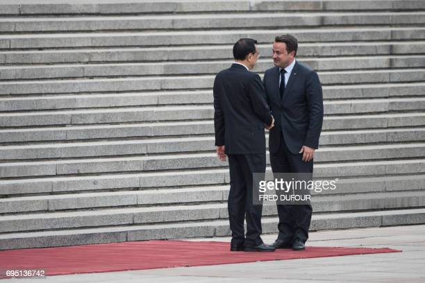 Chinese Premier Li Keqiang greets Luxembourg's Prime Minister Xavier Bettel at a welcoming ceremony at the Great Hall of the People in Beijing on...