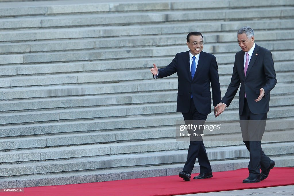 Chinese Premier Li Keqiang (L) invites Singapore Prime Minister, Lee Hsien Loong (R) to view a guard of honour during a welcoming ceremony outside the Great Hall of the People on September 19, 2017 in Beijing, China. At the invitation of Premier Li Keqiang, Prime Minister Lee Hsien Loong of The Republic of Singapore will pay an official visit to China from September 19-21.