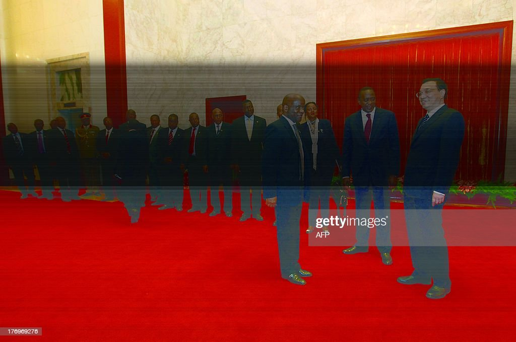 Chinese Premier Li Keqiang (R) meets Kenyan President Uhuru Kenyatta (2-R) and his diplomats during their meeting at the Great Hall of the People in Beijing on August 20, 2013.