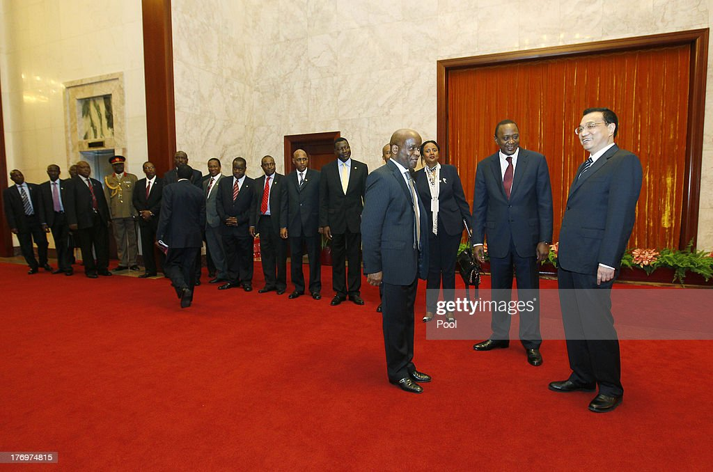 Chinese Premier Li Keqiang (R ) meets Kenyan President Uhuru Kenyatta (2-R) and his diplomats during their meeting at the Great Hall of the People August 20, 2013 in Beijing, China. An agreement was signed between the two countries that will allow mutual visa exemptions for holders of diplomatic service passports.