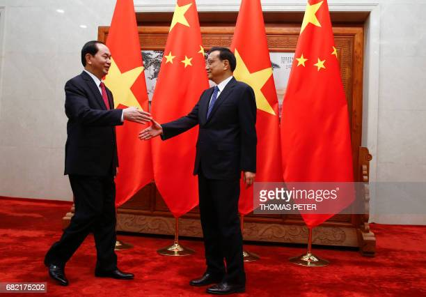 Chinese Premier Li Keqiang meets Vietnam's President Tran Dai Quang at the Great Hall of the People in Beijing on May 12 2017 / AFP PHOTO / POOL /...