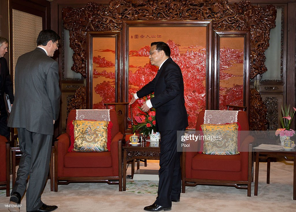 Chinese Premier <a gi-track='captionPersonalityLinkClicked' href=/galleries/search?phrase=Li+Keqiang&family=editorial&specificpeople=2481781 ng-click='$event.stopPropagation()'>Li Keqiang</a>, right, shows the seat to U.S. Treasury Secretary Jacob Lew during their meeting at the Zhongnanhai diplomatic compound on March 20, 2013 in Beijing, China. The U.S. Treasury Secretary is in China for wide-ranging talks with Chinese President Xi Jinping and Chinese Premier <a gi-track='captionPersonalityLinkClicked' href=/galleries/search?phrase=Li+Keqiang&family=editorial&specificpeople=2481781 ng-click='$event.stopPropagation()'>Li Keqiang</a> over the global economy, the exchange rate, trade, cyber-security and North Korea's nuclear programme. US Treasury secretary Jacob Lew met with the newly-elected President of China on Tuesday, Xi Jinping's first meeting with a foreign official since being appointed.