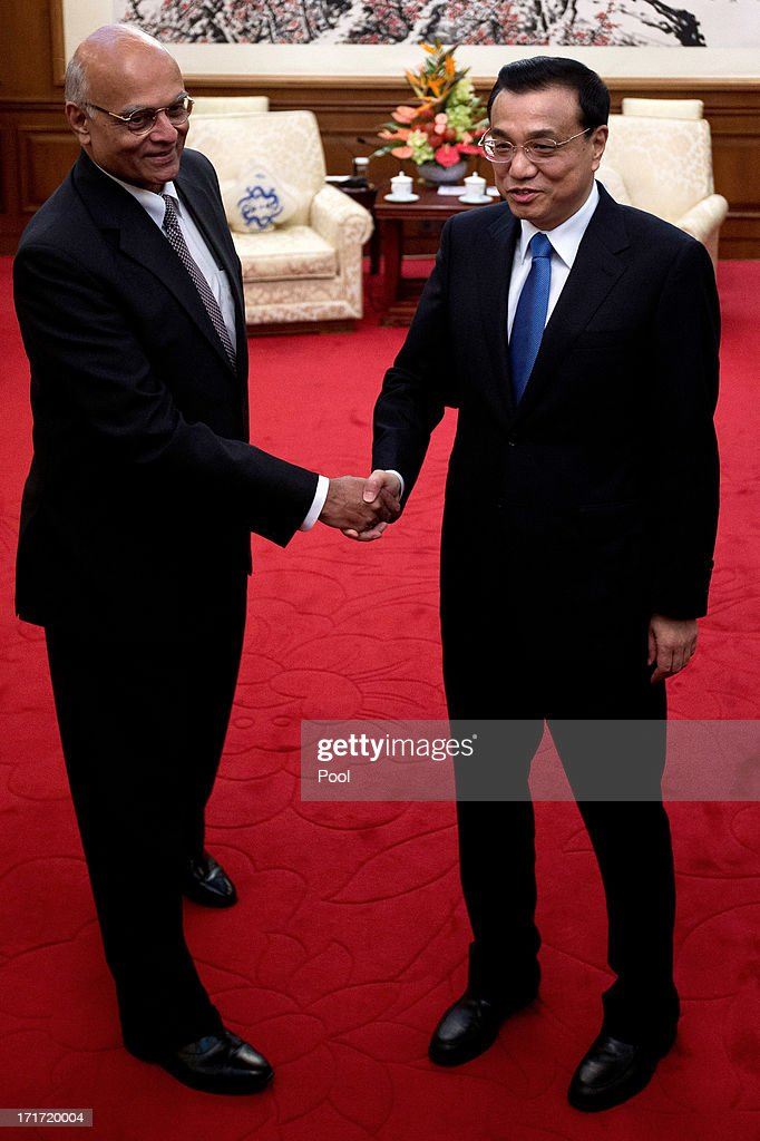 Chinese Premier <a gi-track='captionPersonalityLinkClicked' href=/galleries/search?phrase=Li+Keqiang&family=editorial&specificpeople=2481781 ng-click='$event.stopPropagation()'>Li Keqiang</a> (R) shakes hands with Indian National Security Adviser Shivshankar Menon during their meeting at Diaoyutai State Guesthouse on June 28, 2013 in Beijing, China.