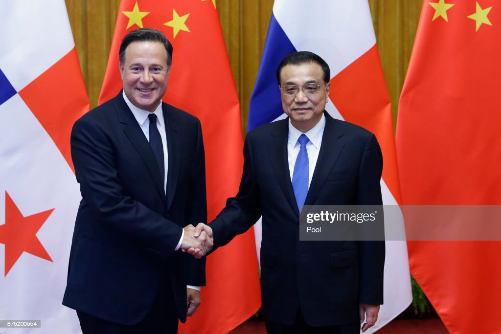 Chinese Premier Li Keqiang (R) shakes hands with Panama's President Juan Carlos Varela before their meeting at the Great Hall of the People on November 17, 2017 in Beijing, China. Panama's President is visiting for bilateral talks, five months after diplomatic relations between the countries were established.