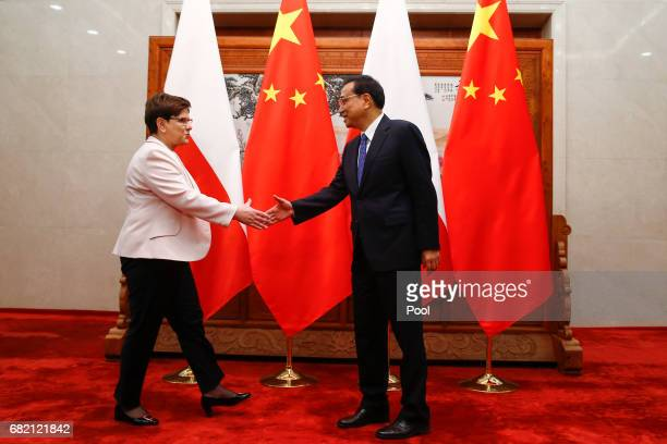 Chinese Premier Li Keqiang shakes hands with Poland's Prime Minister Beata Szydlo before talks at the Great Hall of the People on May 12 2017 in...