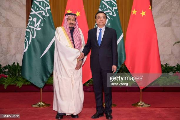 Chinese Premier Li Keqiang shakes hands with Saudi Arabia's King Salman bin Abdulaziz Al Saud at Great Hall of the People on March 17 2017 in Beijing...