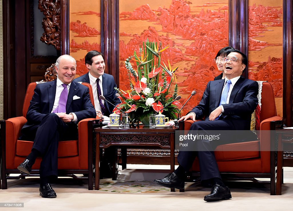 Chinese Premier Li Keqiang (R) shares a light moment with French Foreign Minister Laurent Fabius during a meeting at the Zhongnanhai leadership compound on May 15, 2015 in Beijing, China. Fabius is on a two-day visit to China.