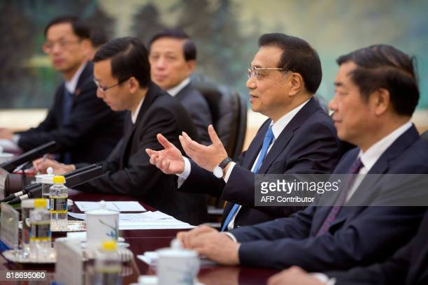 Chinese Premier Li Keqiang speaks during a meeting with Palestinian President Mahmoud Abbas at the Great Hall of the People in Beijing on July 19...