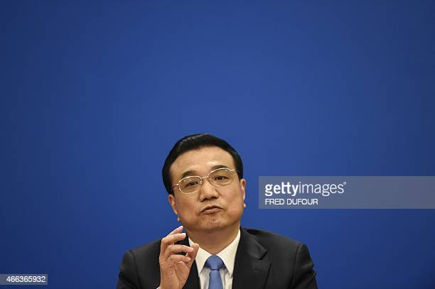 Chinese Premier Li Keqiang speaks during a press conference after the closing ceremony of the annual session of China's legislature the National...