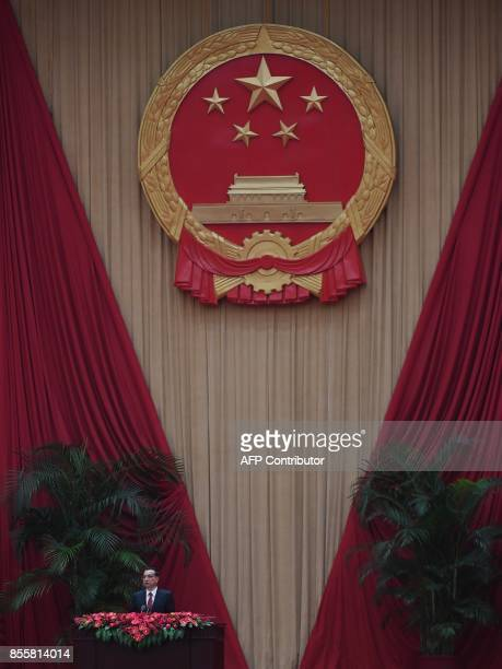 Chinese Premier Li Keqiang speaks during a reception on the eve of China's National Day which marks the 68th anniversary of the founding of the...