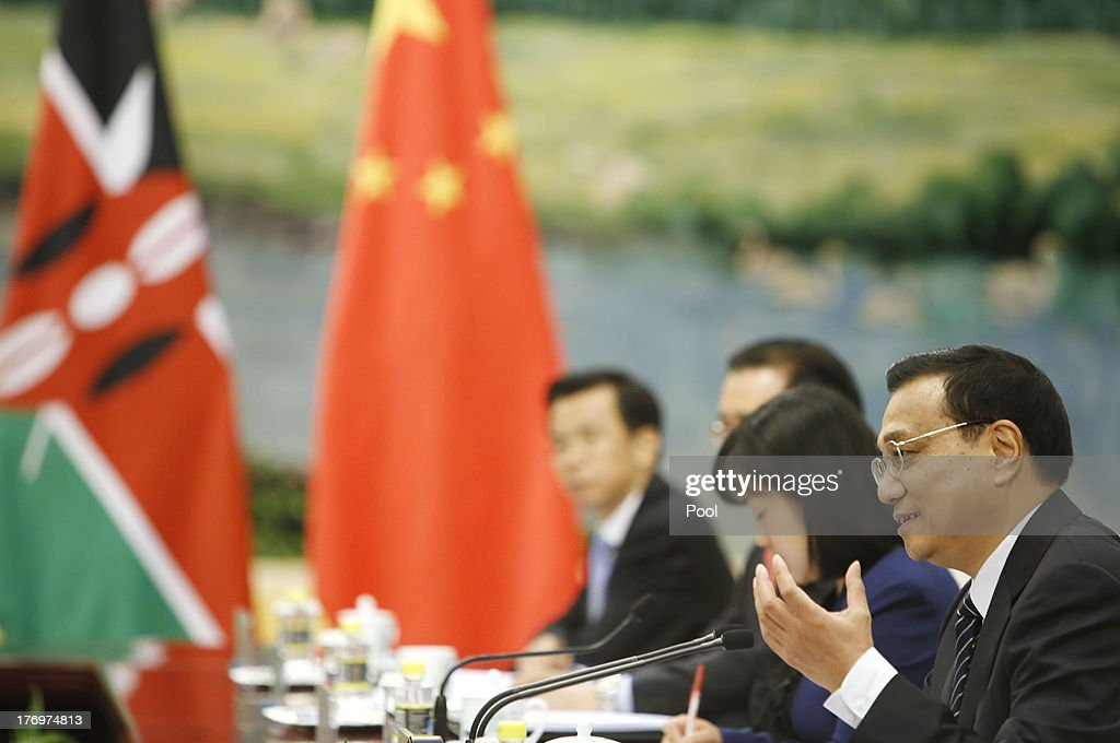 Chinese Premier <a gi-track='captionPersonalityLinkClicked' href=/galleries/search?phrase=Li+Keqiang&family=editorial&specificpeople=2481781 ng-click='$event.stopPropagation()'>Li Keqiang</a> (R ) speaks to Kenyan President Uhuru Kenyatta (not seen) during their meeting at the Great Hall of the People August 20, 2013 in Beijing, China. An agreement was signed between the two countries that will allow mutual visa exemptions for holders of diplomatic service passports.