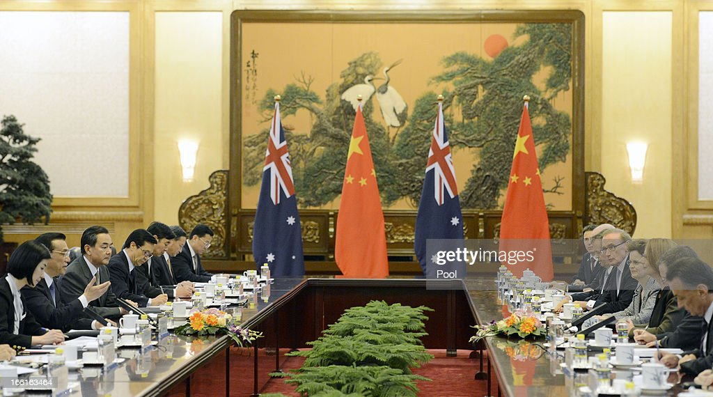 Chinese Premier Li Keqiang (2nd L) speaks with Australia Prime Minister Julia Gillard (3rd R) during a meeting at the Great Hall of the People on April 9, 2013 in Beijing, China. Gillard spoke of building stronger defense ties with China.