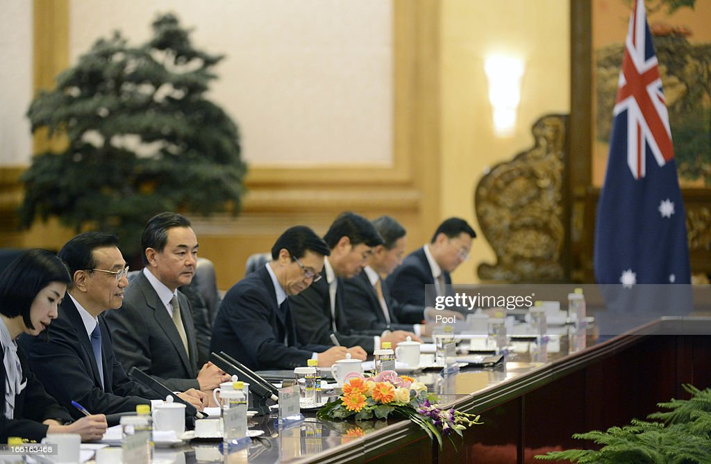 Chinese Premier Li Keqiang (2nd L) speaks with Australia Prime Minister Julia Gillard (not pictured) during a meeting at the Great Hall of the People on April 9, 2013 in Beijing, China. Gillard spoke of building stronger defense ties with China.
