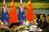 Chinese Premier Li Keqiang speaks with New Zealand's Governor General Jerry Mateparae during a bilateral meeting at the Great Hall of the People in...