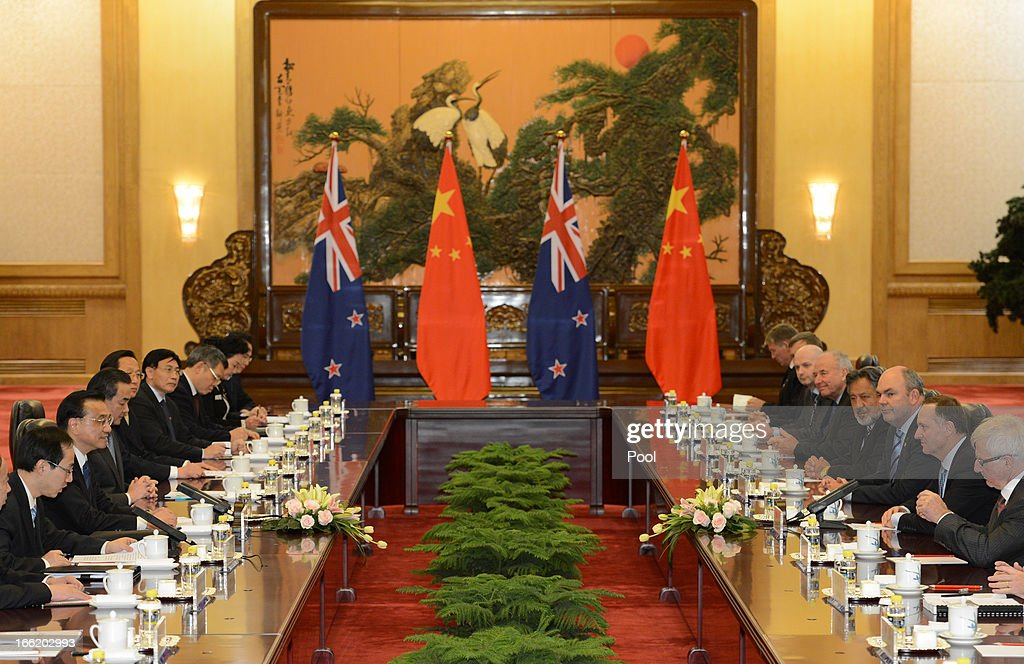 Chinese Premier Li Keqiang speaks with New Zealand's Prime Minister John Key during a meeting at the Great Hall of the People on April 10, 2013 in Beijing, China. Keqiang is hosting a multi day forum welcoming leaders from Mexico, Peru, Kazakhstan, Algeria, Australia, New Zealand and Finland to strengthen diplomatic ties.